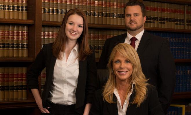Attorneys Catherine Z. Mackey, T.R. Smith and Assistant Lyndsey Stortz